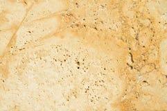 Beige en gouden marmeren textuur stock foto's