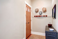 Beige entryway with cabinet, mirror ,hats hanging on the wall Royalty Free Stock Images
