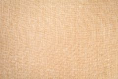 Beige fabric background. Fabric background with a clear structure for insertion Royalty Free Stock Photo