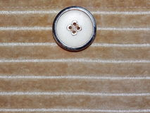 Beige fabric with button Royalty Free Stock Image