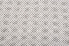 Beige fabric with dots, a background. royalty free stock photos