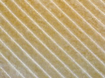 Beige fabric in a gold stripe stock image