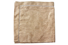 Beige fabric napkin on white Royalty Free Stock Image