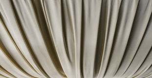 Beige fabric with pleats Royalty Free Stock Image