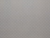 Beige fabric with triangles Stock Images