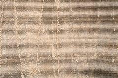 Beige Farbe auf grauem Segeltuch Hintergrund, Beschaffenheit Stockbilder