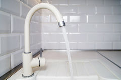 Beige faucet in the kitchen Royalty Free Stock Image