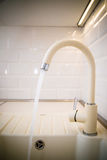 Beige faucet in the kitchen Royalty Free Stock Photos