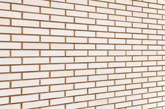 Beige fine brick wall background perspective Stock Photography
