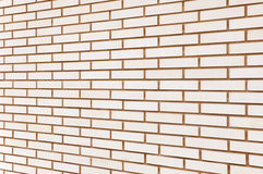 Beige fine brick wall texture background perspective, large detailed horizontal textured pattern Royalty Free Stock Image