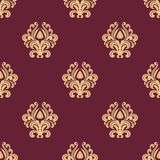 Beige floral seamless pattern on maroon background Royalty Free Stock Image