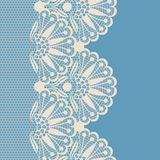 Beige flower lace border. On blue background Royalty Free Stock Photography