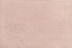 Beige fluffy background of soft, fleecy cloth. Texture of textile closeup Stock Photography