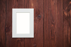 Beige frame without photo on brown wooden desk Stock Photography