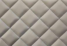 Beige gesteppter Textilhintergrund Lizenzfreie Stockbilder