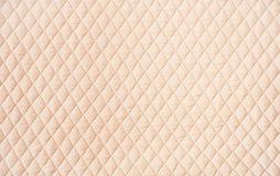 Beige gewatteerde patroonachtergrond Stock Afbeelding