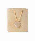 Beige gift bag. Gift bag isolated on white background stock photo