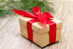Beige gift box with red ribbon, soft focus Royalty Free Stock Photography