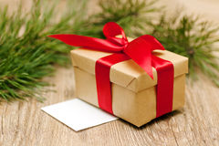 Beige gift box with red ribbon in soft focus Stock Photo