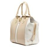 Beige glossy female leather handbag isolated on white background. Stock Photo