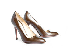 Beige-golden female new varnished shoes on high he Royalty Free Stock Images