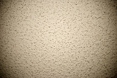 Beige grained wall background or texture Stock Image
