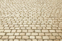 Beige granite mosaic pavement background Royalty Free Stock Photos