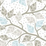 Beige gray blue leaves on branches Stock Image