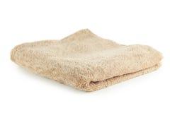 Beige handdoek die op een wit wordt geïsoleerd stock foto's