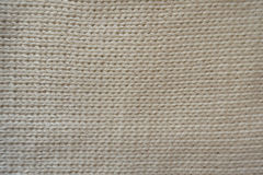 Beige handmade stocking stitch fabric from above Royalty Free Stock Photography