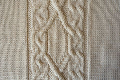 Beige handmade textile with vertical cable knit pattern Royalty Free Stock Photo