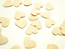 Beige hearts Stock Images