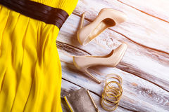 Beige heels and yellow dress. Stock Photography
