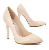 Beige high heel shoes isolated on white Royalty Free Stock Photos