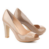 Beige high heel shoes isolated on white background. Stock Photography