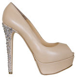 Beige high  heeled shoes Royalty Free Stock Image