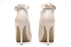 Beige High Heels. Biege High Heels on a White Background royalty free stock photography