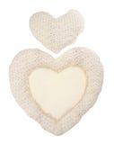 Beige hjärta för kudde på white Arkivfoton