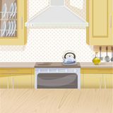 Beige interior of kitchen with stove Royalty Free Stock Photo