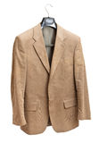 Beige jacket on hanger Royalty Free Stock Image