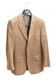 Beige jacket on hanger. Isolated on white background Royalty Free Stock Image