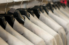 Beige jackets on hangers Stock Photo