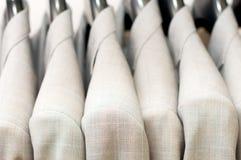 Beige jackets on hangers. Stock Photography
