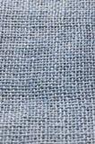 Beige jute. Closeup of blue jute backcloth royalty free stock photo