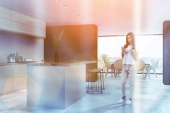 Beige kitchen and dining room corner, bar, woman stock photography