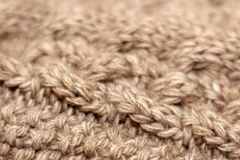 Beige knitted background medium thickness thread royalty free stock photo