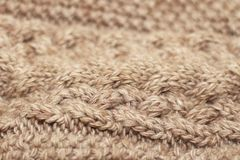 Beige knitted background medium thickness thread royalty free stock images