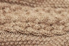 Beige knitted background medium thickness thread royalty free stock image