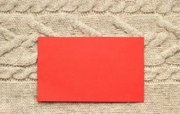 Beige knitted background and red paper Stock Photography