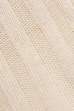 Beige knitted fabric. Royalty Free Stock Photo